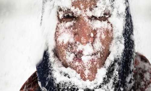 A human face covered in ice and snow
